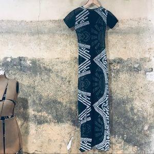 Marina Prokopiva black and white sheer net dress
